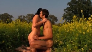 Wet increased by curvy brunette hair makes out with her stud in flower field